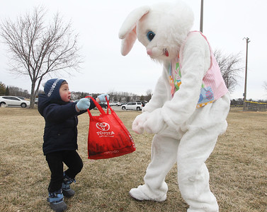 Candace H. Johnson-For Shaw Media Tim Lawitz, 2, of Wauconda shows the Easter Bunny how many plastic eggs he picked up in Cook Park after the Annual Egg Hunt next to the Community Center in Wauconda.The event was sponsored by the Wauconda Park District.(3/24/18)
