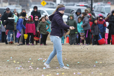Candace H. Johnson-For Shaw Media Krysta Flaherty, 15, of Island Lake drops some candy beside the plastic eggs in Cook Park during the Annual Egg Hunt next to the Community Center in Wauconda.The event was sponsored by the Wauconda Park District.(3/24/18)