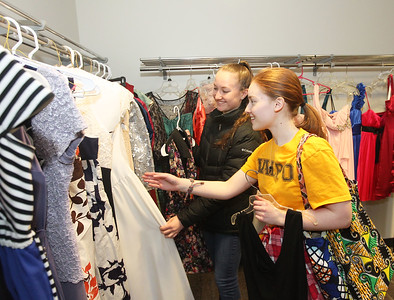 Candace H. Johnson-For Shaw Media Kelly Poyo, 16, and Anna Leichty, 18, both of Wauconda look at beautiful dresses given away for free at the Prom Dress Shoppe at the Wauconda Area Library.