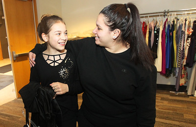 Candace H. Johnson-For Shaw Media Adelynn Follett, 14, of Crystal Lake and her cousin, Lilia Zeffery, 18, of Wauconda are all smiles as they pick out dresses together at the Prom Dress Shoppe at the Wauconda Area Library.