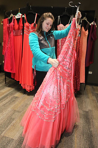 Candace H. Johnson-For Shaw Media Madison Jensen, 18, of Wauconda looks at a dress she can wear to the Wauconda High School prom as she makes her decision on which dress she will want to take home for free in the Prom Dress Shoppe at the Wauconda Area Library.