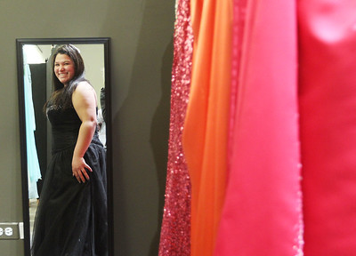 Candace H. Johnson-For Shaw Media Lilia Zeffery, 18, of Wauconda smiles as she finds the perfect dress for her prom as she looks in the mirror at the Prom Dress Shoppe at the Wauconda Area Library.