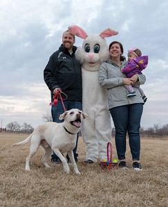 The Kunstman family from Woodstock posed with the Easter Bunny Wednesday, March 28, 2018 at the Doggy Easter egg hunt at Hoffman Dog Park in Cary.  KKoontz- For Shaw Media