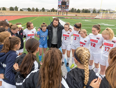 Huntley's girls' soccer head coach Matt Lewandowski talks to his team prior to the game Wednesday, March 28, 2018 in Huntley. Huntley went on to win the game beating Elgin 3-0. KKoontz- For Shaw Media