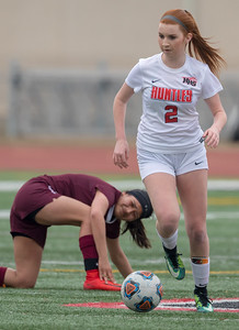 Huntley's Braidy Ceh (2) brings the ball past an Elgin defender Wednesday, March 28, 2018 in Huntley. Huntley went on to win the game beating Elgin 3-0. KKoontz- For Shaw Media