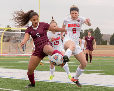 Huntley's Savanna Zoellner (Right) battles it out against Elgin's Guadalupe Sanchez (Left) Wednesday, March 28, 2018 at Huntley High School. Huntley went on to win 3-0.  KKoontz- For Shaw Media