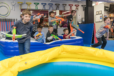 The Battle begins! From their starting spots on opposite sides of the gym, kids rush to take their positions during the Nerf War Games held Saturday, March 31, 2018 in Woodstock. The Young Master Martial Arts holds the event at their facility on the Woodstock Square throughout the year.  KKoontz – For Shaw Media