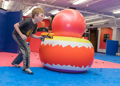 Maximus Baker (age 8) from Crystal Lake sneaks into enemy territory during the Nerf War Games Saturday, March 31, 2018 in Woodstock. The Young Master Martial Arts holds the event at their facility on the Woodstock Square throughout the year.  KKoontz – For Shaw Media