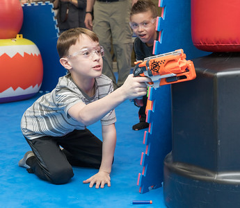 Paxson (age 8) from Woodstock takes careful aim during the Nerf War Games held Saturday, March 31, 2018 in Woodstock. The Young Master Martial Arts holds the event at their facility on the Woodstock Square throughout the year.  KKoontz – For Shaw Media