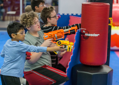 """Survivor"", ""Capture the Flag"" and ""Barbarians"" are just some of the games that over thirty kids played during the Nerf War Games Saturday, March 31, 2018 in Woodstock. The Young Master Martial Arts holds the event at their facility on the Woodstock Square throughout the year.  KKoontz – For Shaw Media"