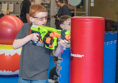 "Logan Crowell (age 11) from Woodstock looks for the ""enemy"" during the Nerf War Games held Saturday, March 31, 2018 in Woodstock. The Young Master Martial Arts holds the event at their facility on the Woodstock Square throughout the year.  KKoontz – For Shaw Media"