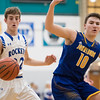 Whitney Rupp for Shaw Media<br /> Burlington Central's Jake Lenschow eyes the ball after Mason Sobiesk of Johnsburg loses control in the Class 3A sectional semifinal Tuesday, March 6.