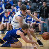 Whitney Rupp for Shaw Media<br /> Zach Schutta of Burlington Central fights to keep the ball inbounds alongside Johnsburg's Alec Smith Tuesday, March 6 in the Class 3A sectional semifinal game.