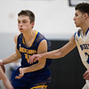 Whitney Rupp for Shaw Media<br /> Patrick Mayfield of Burlington Central guards Johnsburg's Zach Toussaint in the Class 3A sectional semifinal game Tuesday, March 6.