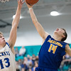 Whitney Rupp for Shaw Media<br /> Caden Scott of Burlington Central tries for a block against Johnsburg's Zach Toussaint Tuesday, March 6 in the Class 3A sectional semifinal game.
