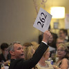 """Bob Schrieber of Sleepy Hollow makes a bid during the CASA Kane County """"Spring In Paris Gala"""" fundraiser at the Q Center in St. Charles on March 3."""