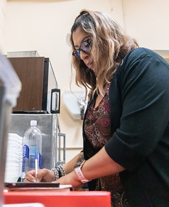 Lily Reyes delivers goes over paperwork at Chi-Cal Kitchen which operates within the Woodstock Veterans of Foreign Wars Post 5040 Friday, March 1, 2019 in Woodstock. Reyes along with fiancé Cal Gordon and other family members own and operate the business which also caters events in the area.  KKoontz – For Shaw Media
