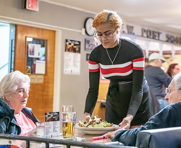 Harvard high school student Angalese Dodson delivers customers their order Monday, March 1, 2019 at the Woodstock Veterans of Foreign Wars Post 5040 Friday, March 1, 2019 in Woodstock. Her mother, Lily Reyes, along with her fiancé Carl Gordon, own and operate Chi-Carl Kitchen which is located within the VFW.  KKoontz – For Shaw Media