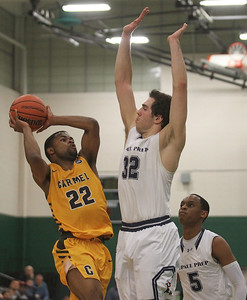 Candace H. Johnson-For Shaw Media Carmel's Kylen Beals leaps up for a shot against DePaul Prep's Pavle Pantovic and Lance Mosley in the third quarter during the Class 3A sectional semifinal game at Grayslake Central High School. DePaul Prep won 57-46.