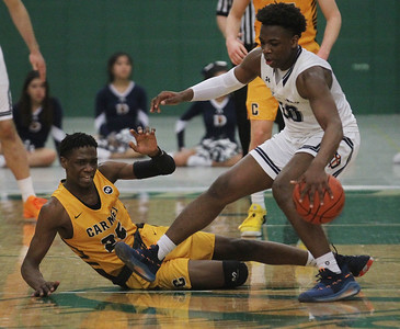 Candace H. Johnson-For Shaw Media Carmel's Bryce Moore goes down as DePaul Prep's Raheem Anthony takes control of the ball in the fourth quarter during the Class 3A sectional semifinal game at Grayslake Central High School. DePaul Prep won 57-46.