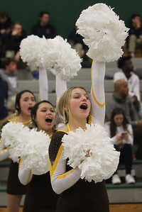 Candace H. Johnson-For Shaw Media Carmel's Kaylie McDonough, of Gurnee, Ella Madrigal, of Grayslake, both 16, and Abby Bonds, 15, of Hawthorn Woods cheer on the boys basketball team as they play DePaul Prep in the fourth quarter during the Class 3A sectional semifinal game at Grayslake Central High School. DePaul Prep won 57-46.