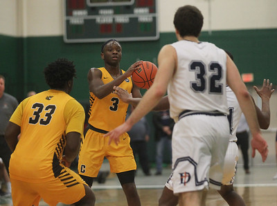 Candace H. Johnson-For Shaw Media Carmel's Damone Williams-Gray looks to pass against DePaul Prep's Pavle Pantovic in the third quarter during the sectional semifinal game at Grayslake Central High School. DePaul Prep won 57-46.