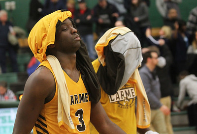 Candace H. Johnson-For Shaw Media Carmel's Damone Williams-Gray and Jalen Snell walk off the court after their team lost to DePaul Prep 57-46 during the Class 3A sectional semifinal game at Grayslake Central High School.