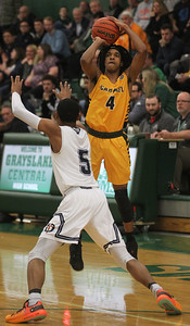 Candace H. Johnson-For Shaw Media Carmel's Kimahri Wilson aims for the hoop against DePaul Prep's Lance Mosley in the first quarter during the Class 3A sectional semifinal game at Grayslake Central High School. DePaul Prep won 57-46.