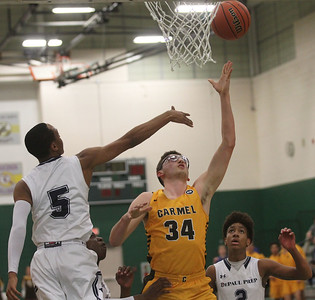 Candace H. Johnson-For Shaw Media Carmel's Jonathan Roeser (#34) aims for the hoop against DePaul Prep's Lance Mosley (#5) in the first quarter during the Class 3A sectional semifinal game at Grayslake Central High School. DePaul Prep won 57-46.