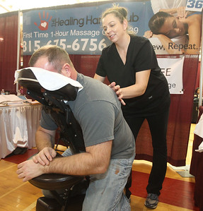 Candace H. Johnson-For Shaw Media Jeff Austin, of McHenry gets a chair massage by Kasia Bussan, of Ingleside, a licensed massage therapist, with The Healing Hands Club, in Spring Grove during the Business & Craft Expo at Grant Community High School in Fox lake. The event was sponsored by the Fox Lake, Richmond and Spring Grove Area Chamber of Commerce. (3/2/19)