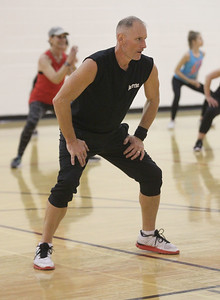 Candace H. Johnson-For Shaw Media Shawn Hendricks, of McHenry works out in a Fox Lake Jazzercise demonstration during the Business & Craft Expo at Grant Community High School in Fox lake. The event was sponsored by the Fox Lake, Richmond and Spring Grove Area Chamber of Commerce. (3/2/19)
