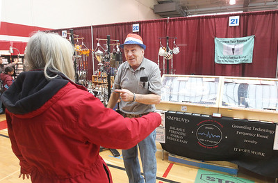 Candace H. Johnson-For Shaw Media Ginny Charvat, of Antioch has her balanced checked by Phil Nocerino, of Lindenhurst who was selling his Frequency-R-us Products that help to improve balance, strength and energy during the Business & Craft Expo at Grant Community High School in Fox lake. Charvat was at the event with her husband, Bruce.The event was sponsored by the Fox Lake, Richmond and Spring Grove Area Chamber of Commerce. (3/2/19)