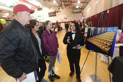 Candace H. Johnson-For Shaw Media Jeff, Kathy and Cassidy Berchtold, 13, of Lindenhurst listen to Cristal Grifaldo, of Round Lake, supervisor, talk about upgrading the seats at the Classic Cinemas Fox Lake Theatre during the Business & Craft Expo at Grant Community High School in Fox lake. The event was sponsored by the Fox Lake, Richmond and Spring Grove Area Chamber of Commerce. (3/2/19)