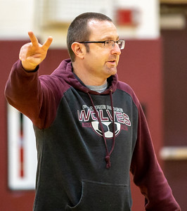 Prairie Ridge girls' soccer head coach Mark Lewis runs practice inside the high school gym Tuesday, March 12, 2019 in Crystal Lake. Weather has forced the team to hold practices indoors.  KKoontz – For Shaw Media