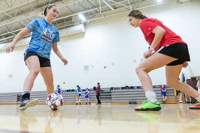 Prairie Ridge's Nicole Anderson (left) and Lucy Klimkowski run through soccer drills during practice Tuesday, March 12, 2019 in Crystal Lake. KKoontz – For Shaw Media