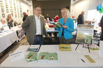 """Candace H. Johnson-For Shaw Media Author Thomas Bachhuber, of Wauconda talks to Kelly Kuningas, adult services librarian, about his book, """"Transpirations: Guidance for the Head & Heart through Career and Beyond,"""" during the Local Author Fair at the Wauconda Area Library. (3/9/19)"""