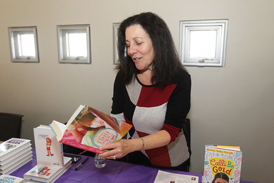 """Candace H. Johnson-For Shaw Media Michele Weber Hurwitz, of Buffalo Grove, a middle grade fiction author, reads a passage from her book, """"The Summer I Saved the World in 65 Days,"""" during the Local Author Fair at the Wauconda Area Library. (3/9/19)"""