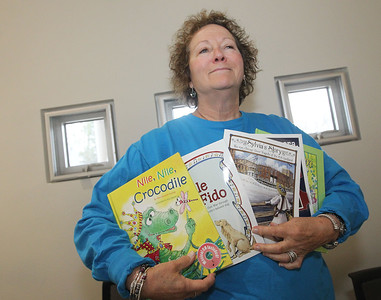 Candace H. Johnson-For Shaw Media Author Mary Furlong, of Wauconda, a former music teacher, holds up five children's books she has published during the Local Author Fair at the Wauconda Area Library.The music-based books each hold a compact disc of original music. The books can be found on Amazon, Book Bin, in Wilmette and Book World in Janesville, Wis.(3/9/19)