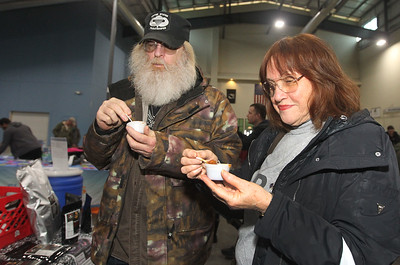 Candace H. Johnson-For Shaw Media Dave and Hilda Dushefski, of Round Lake Heights taste a sample of barbeque smoked beans made by AfterShock Preparedness during the Survival & Green Living Expo at the Lake County Fairgrounds in Grayslake. (3/10/19)