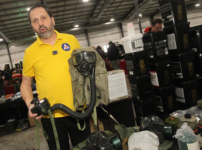 Candace H. Johnson-For Shaw Media Craig Douglas with The Prepper Stop talks about a M40 gas mask he was selling during the Survival & Green Living Expo at the Lake County Fairgrounds in Grayslake. (3/10/19)