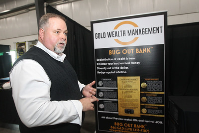 Candace H. Johnson-For Shaw Media Wes Peters, of Phoenix, Arizona with Gold Wealth Management talks about the personal Bug Out Banks he was selling which contained different amounts of gold and silver during the Survival & Green Living Expo at the Lake County Fairgrounds in Grayslake. (3/10/19)