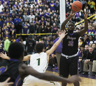 Candace H. Johnson-For Shaw Media Waukegan's Kavon Colder (# 35) looks to pass against Stevenson's John Ittounas (#1) in the first quarter during the Class 4A sectional final at Waukegan High School. Stevenson won 56-41. (3/8/19)