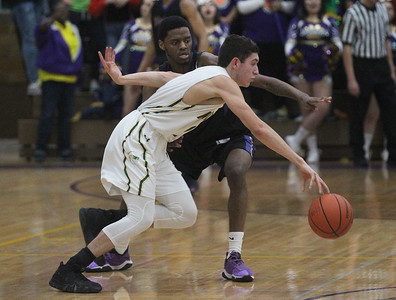Candace H. Johnson-For Shaw Media Waukegan's Jaylin Cunningham guards Stevenson's John Ittounas in the second quarter during the Class 4A sectional final at Waukegan High School. Stevenson won 56-41. (3/8/19)