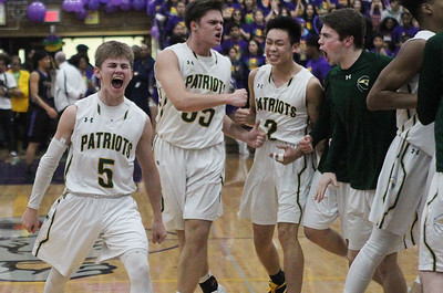 Candace H. Johnson-For Shaw Media Stevenson's Evan Ambrose (#5) and his team celebrate after scoring against Waukegan in the second quarter during the Class 4A sectional final at Waukegan High School. Stevenson won 56-41. (3/8/19)