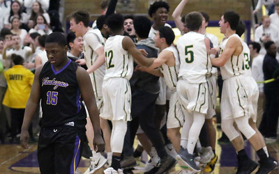 Candace H. Johnson-For Shaw Media Waukegan's Nakeitheis Myers walks off the court as Stevenson celebrates after beating Waukegan 56-41 during the Class 4A sectional final at Waukegan High School. (3/8/19)