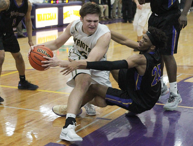 Candace H. Johnson-For Shaw Media Stevenson's Matt Kaznikov and Waukegan's Bryant Brown battle for control in the fourth quarter during the Class 4A sectional final at Waukegan High School. Stevenson won 56-41. (3/8/19)