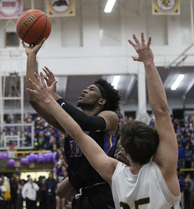 Candace H. Johnson-For Shaw Media Waukegan's Bryant Brown leaps up for a shot against Stevenson's Matt Kaznikov in the second quarter during the Class 4A sectional final at Waukegan High School. Stevenson won 56-41. (3/8/19)