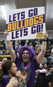 Candace H. Johnson-For Shaw Media Waukegan's John Imdlecoffer, a teacher at the high school, cheers on the varsity boys basketball team as they play Stevenson in the fourth quarter during the Class 4A sectional final at Waukegan High School. Stevenson won 56-41. (3/8/19)