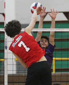 Candace H. Johnson-For Shaw Media Grant's Derek Kolb makes an attack against Waukegan's Marcus Bahena in the first set during the season opener at Waukegan High School. Waukegan won 25-15, 25-11. (3/19/19)
