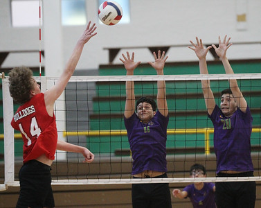 Candace H. Johnson-For Shaw Media Grant's Jacob Andersen makes an attack against Waukegan's Kenneth Hernandez and Roberto Gonzalez in the first set during the season opener at Waukegan High School. Waukegan won 25-15, 25-11. (3/19/19)